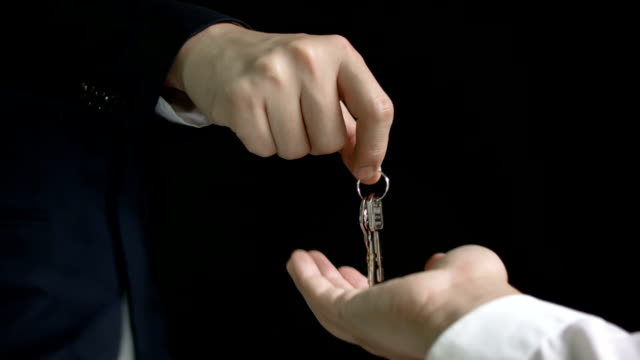 Businessman gives the keys video