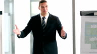 Businessman giving presentation in conference room video