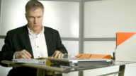 businessman going over his paperwork video