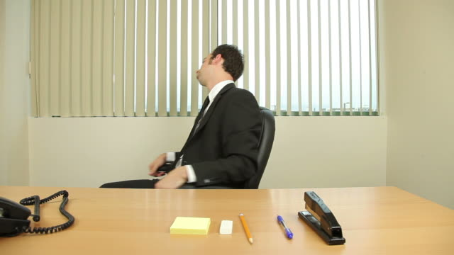 Businessman Goofing Off At Work video