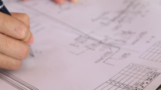 HD: Businessman hand checking construction blueprint video