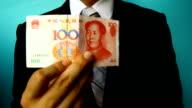 businessman hand hold china money bill video