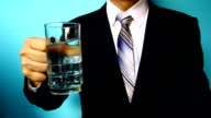 businessman hand hold drink water video