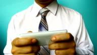 businessman hand hold phone video