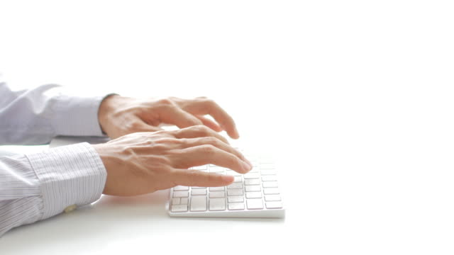 Businessman hands typing on keyboard on white background for add text video