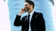 Businessman happy with success using smart phone video