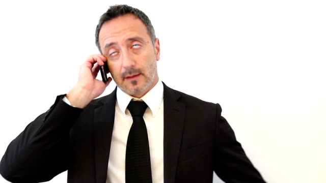 Businessman has stress and screams in telephone video