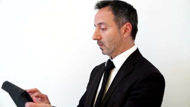 Businessman have trouble with digital tablet video