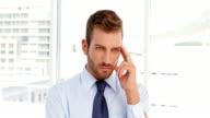 Businessman having a headache video