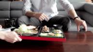 Businessman having lunch at restaurant video