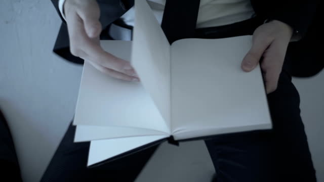 Businessman Holding A Blank Page video