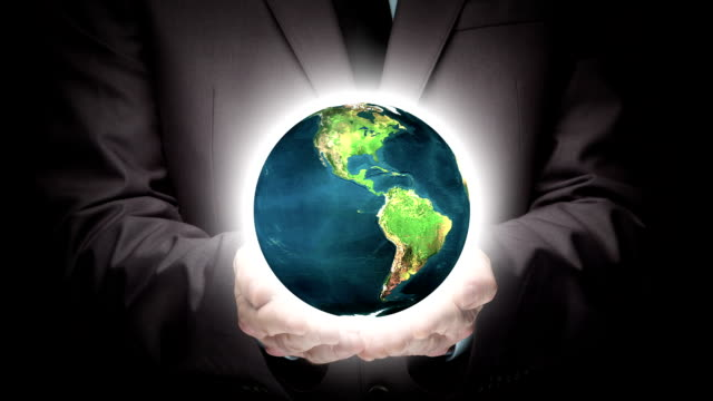 Businessman holding illuminated globe video