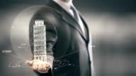 Businessman holding in Hand Landmark Leaning Tower of Pisa New technologies video