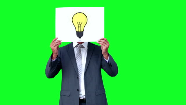 Businessman holding light bulb animation over face video