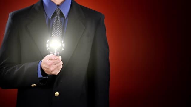 Businessman Holding Light Bulb video
