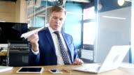 Businessman Holding Paper Plane, Thinking an Idea video