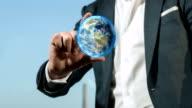 Businessman Holds Earth Globe | 4K video