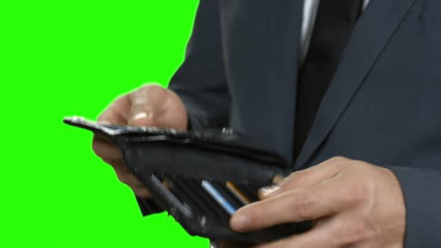Businessman holds one dollar bill. video