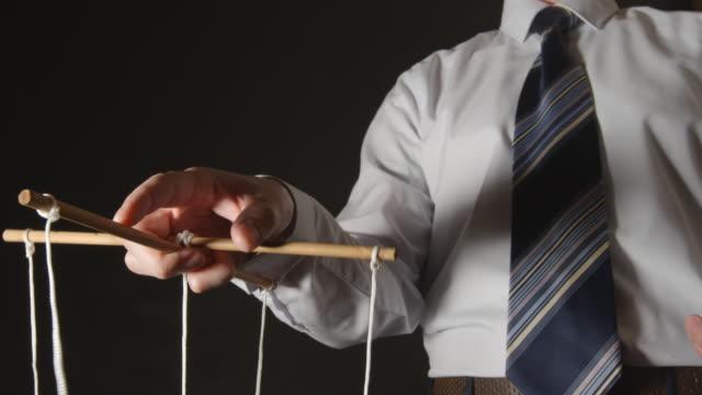 MANIPULATION: Businessman in a shirt manipulating video