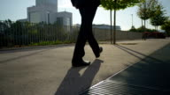 CLOSE UP: Businessman in a suit walking along business district video