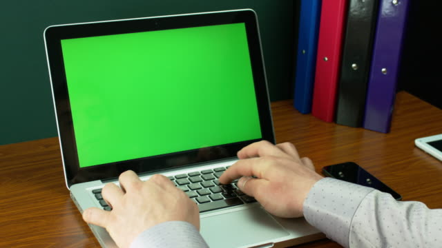 Businessman In Light Brown Shirt Typing On A Laptop With Green Screen. video