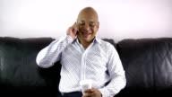 Businessman in living room talking on phone video