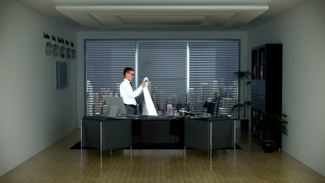 Businessman in Office Reading a Long Bill and City Skyline video