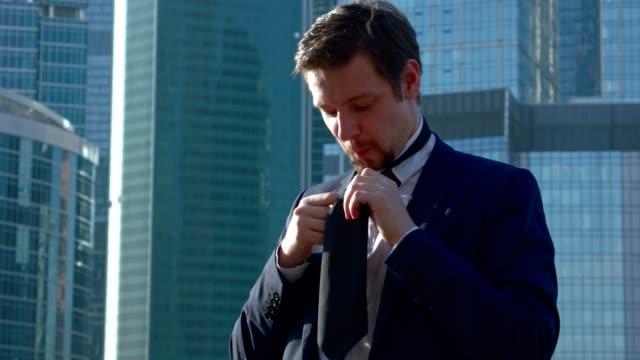 Businessman in White Shirt Tying a Tie. video