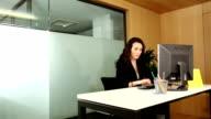 Businessman interrupts working businesswoman for her signature video