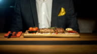 Businessman is waiting order in a steak bar or restaurant video