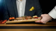 Businessman is waiting order in a steak bar or restaurant video