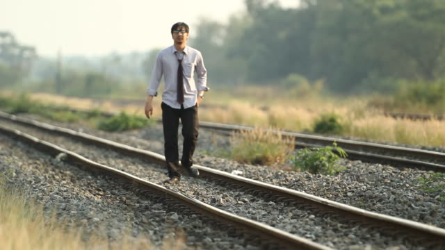 HD : Businessman is walking alone on railroad video