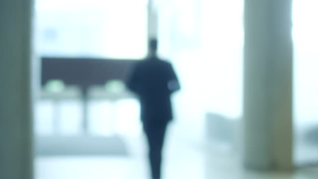 Businessman is Walking Away. Shallow depth of Field video