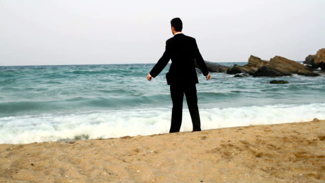Businessman jumping in water beach awaited vacation concept video