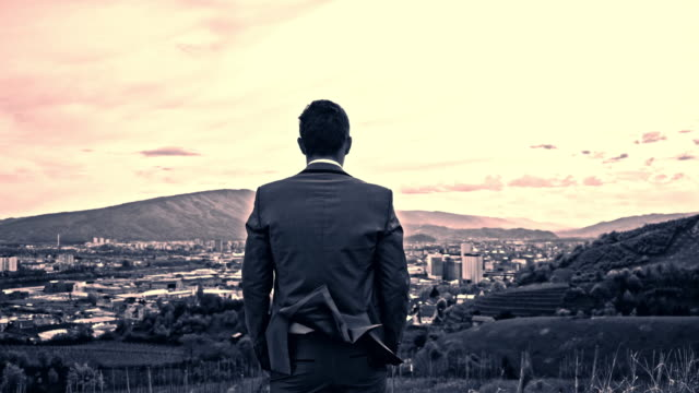 Businessman looking across the city video