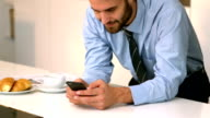 Businessman looking at his phone video