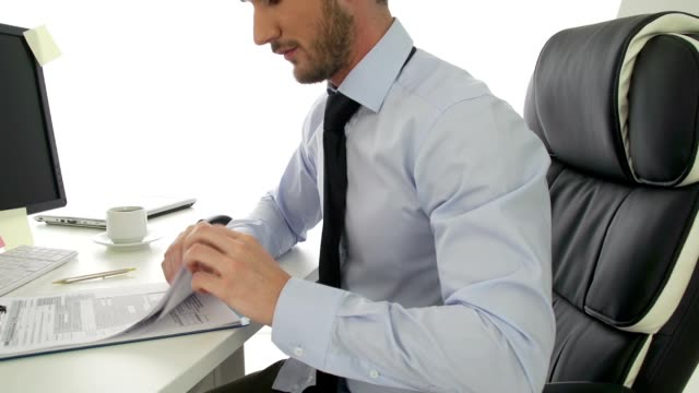 Businessman looking at tax forms video