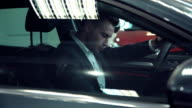 Businessman looking interior of the new car video