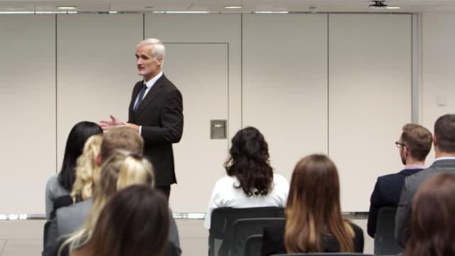 Businessman Making Presentation At Conference Shot On R3D video