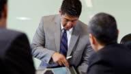Businessman making presentation with digital tablet video