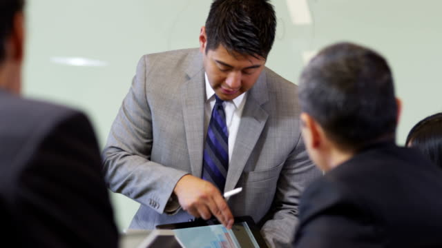 Businessman making presentation with digital tablet video