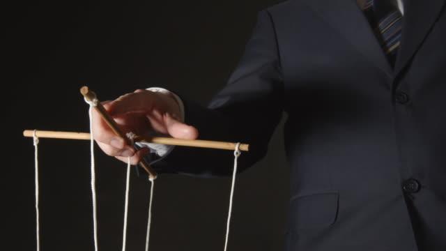 MANIPULATION: Businessman manipulating video