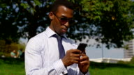 Businessman Near Office Building Sending Email With Cell Phone video