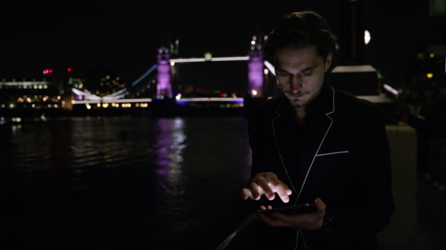 DS Businessman near the Tower Bridge at night video