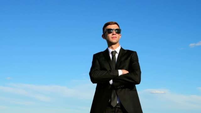 Businessman On Blue Sky Background video