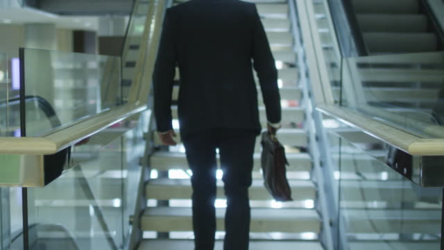 Businessman on Climbing the Stairs. Strait shot. video