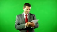 Businessman on Digital Tablet in front of Green Screen video