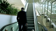 Businessman on Escalator video
