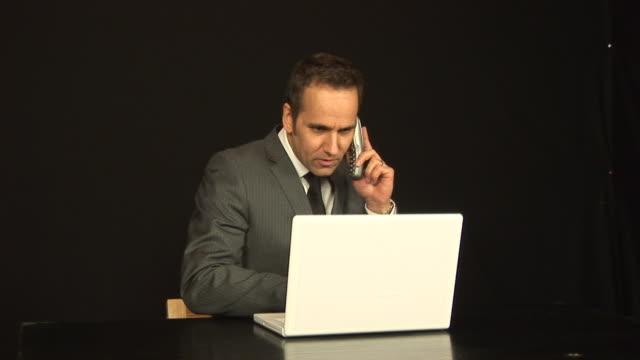 Businessman on phone - HD & PAL video