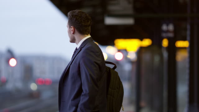 Businessman On Platform Waiting For Train Shot On R3D video
